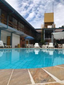 The swimming pool at or near Hotel e Pousada Pouso54