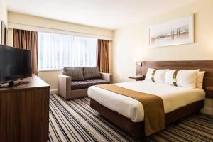 A bed or beds in a room at Holiday Inn Norwich North, an IHG Hotel