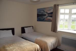 A bed or beds in a room at The Watling Inn