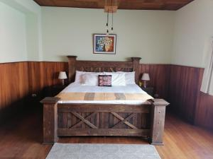 A bed or beds in a room at Hotel Muchá