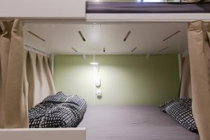 A bed or beds in a room at Backpackers