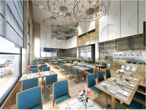 A restaurant or other place to eat at Grand Swiss-Belhotel Waterfront Seef