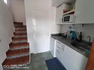 Een keuken of kitchenette bij Green Oasis Club