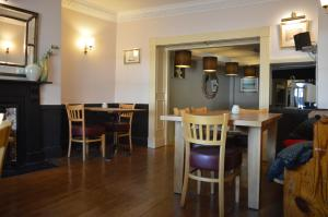 A restaurant or other place to eat at The Ilchester Arms Hotel