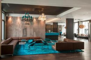 The lobby or reception area at Motel One Brussels