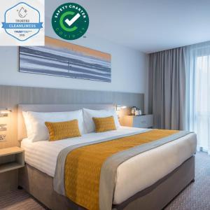Un ou plusieurs lits dans un hébergement de l'établissement Maldron Hotel Parnell Square