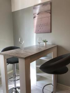 A kitchen or kitchenette at Hotel U. + Apartments