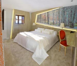 Cama o camas de una habitación en Hotel Las Treixas