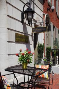 A television and/or entertainment center at Rittenhouse 1715 - A Boutique Hotel