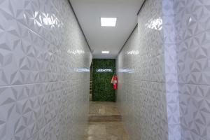 A bathroom at USEHOTEL - A uma quadra do complexo hospitalar Santa Casa - Estacionamento gratuito