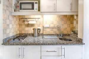 Una cocina o kitchenette en Departamento en Bariloche