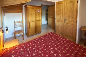 Un ou plusieurs lits dans un hébergement de l'établissement Le Col Roulé