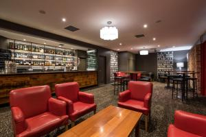 The lounge or bar area at The Old Woolstore Apartment Hotel