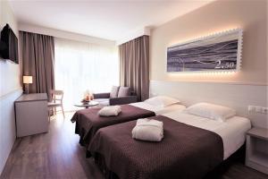 Ein Bett oder Betten in einem Zimmer der Unterkunft Strand Spa & Conference Hotel
