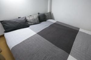 Кровать или кровати в номере Studio on Sredny prospect VO 51