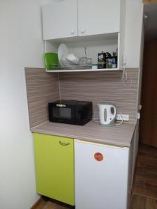 Кухня или мини-кухня в Studio on Sredny prospect VO 51