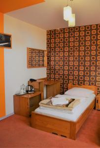 Ein Bett oder Betten in einem Zimmer der Unterkunft Pałac Siemczyno