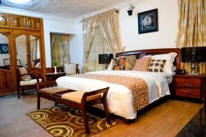 A bed or beds in a room at Crystal House International Hotel