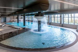 The swimming pool at or close to NH Noordwijk Conference Centre Leeuwenhorst