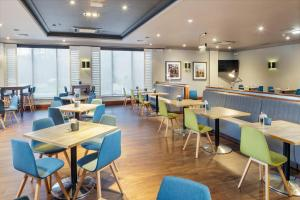 A restaurant or other place to eat at Holiday Inn Peterborough West, an IHG Hotel