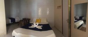 A bed or beds in a room at Pousada Bellas Águas
