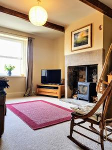 A television and/or entertainment center at Riding Head Cottage Luddenden