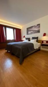 Кровать или кровати в номере Hotel Casino