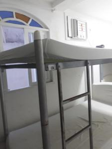 A bunk bed or bunk beds in a room at Pousada Divino Hospedagens e SPA