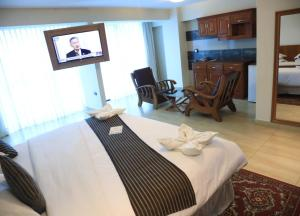 A bed or beds in a room at Samiria Jungle Hotel