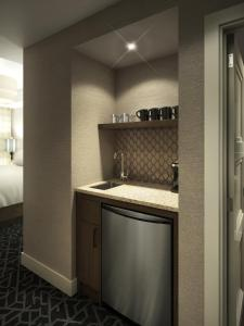 A kitchen or kitchenette at Malcolm Hotel by CLIQUE
