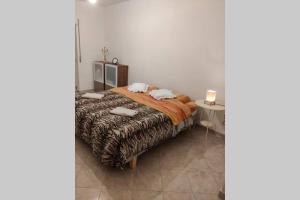A bed or beds in a room at Salerno-Costiera B&B appartamento elegante