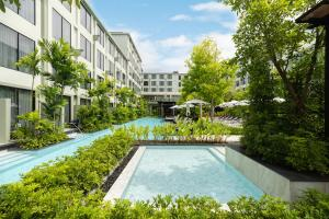 The swimming pool at or near Four Points by Sheraton Phuket Patong Beach Resort - SHA Plus