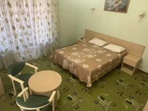 Кровать или кровати в номере Bourgeoisie Guest House