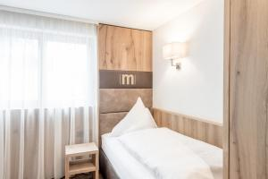 A bed or beds in a room at Hotel Mondin