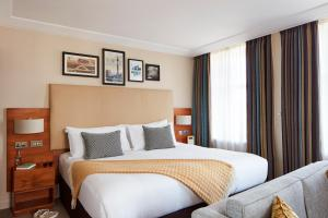 A bed or beds in a room at The Clermont London, Charing Cross