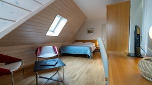 Кровать или кровати в номере Hôtel du Cheval Blanc