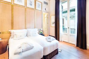 Cama o camas de una habitación en Sonder l DO Plaça Reial