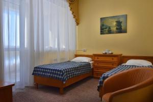 Кровать или кровати в номере Mirit Hotel ФГУП РСВО
