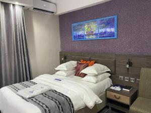 A bed or beds in a room at Whitefield Hotels Limited