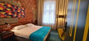 Łóżko lub łóżka w pokoju w obiekcie Hotel Tobaco Łódź