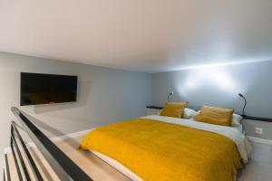 Кровать или кровати в номере Soon Room