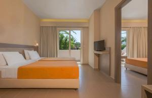 A bed or beds in a room at Hotel Esperia