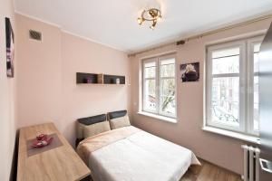 Łóżko lub łóżka w pokoju w obiekcie Gdańskie Apartamenty - Old Town Grobla Rooms & Apartments