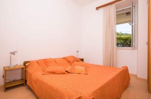 Łóżko lub łóżka w pokoju w obiekcie Apartments Vidak