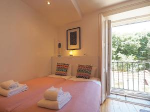 A bed or beds in a room at Aurora - Lissabon Altstadt
