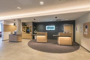 The lobby or reception area at Holiday Inn Express - Wuppertal - Hauptbahnhof, an IHG Hotel