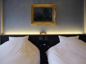 A bed or beds in a room at Mizno Hotel