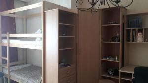 A bunk bed or bunk beds in a room at Хостел на Фрунзе 63