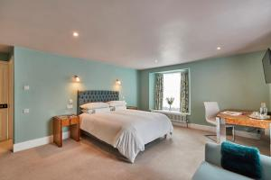 A bed or beds in a room at Rook Lane House