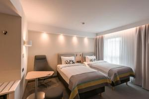 A bed or beds in a room at Holiday Inn Express - Wuppertal - Hauptbahnhof, an IHG Hotel